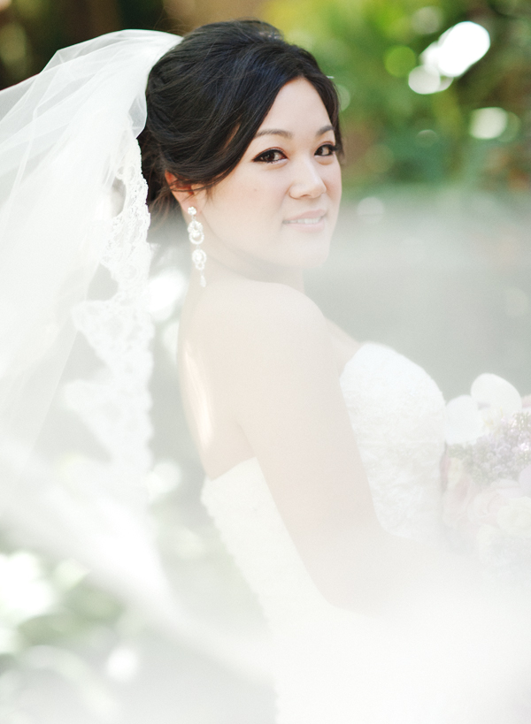 a bride with a cathedral length veil in the wind