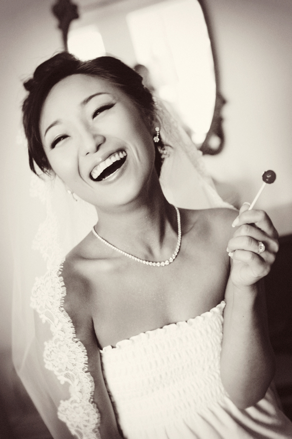 Bride laughing and having fun while getting ready for her wedding at the Ebell in Los Angeles